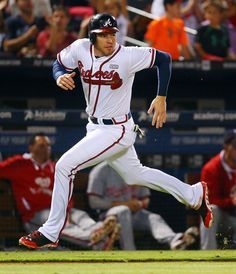 Braves Freddie Freeman heads home to score on a hit by Christian Bethancourt to take a 3-1 lead over the Nationals during the sixth inning of a baseball game on Wednesday, Sept. 17, 2014, in Atlanta.
