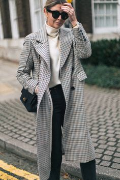 Emma Hill wears Celine sunglasses, check coat, vintage chanel bag, black jeans, sock boots, cream sweater, winter fashion, outfit idea