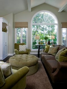 light grey walls, chocolate brown sofa, sage green accent color and large windows love the colors family room Living Room Color Schemes, Paint Colors For Living Room, Living Room Designs, Living Room Green, New Living Room, Living Room Decor, Cozy Living, Light Green Walls, Contemporary Family Rooms