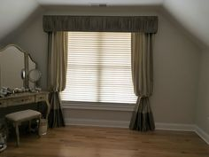 Shirred Cornice, over Bishop Sleeve Draperies with Block Bottom, over Wood Blinds