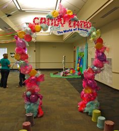 Candyland arch...We made candy from paper plates, balloons, and cotton candy from Poly fill spay painted.