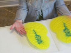 plexiglass taped into book form.  Squirt with paint and fold.  Lay paper on to make a print.  Add more paint.