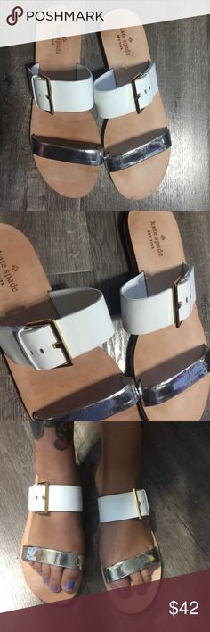 Kate Spade white and silver leather sandals 9 10 Kate Spade white and silver leather sandals 9 10 -so cute and perfect for summer! Only worn a few times - like new - marked size 10 but adjustable gold buckle and straps fits a 9 and in between sizes too! will fit sizes 9 -10  - bundle and save! Lots of designer goodies! Moving sale! Buy now!!! Save on shipping the more you buy! Ask for a bundle! Cheers! Xoxo kate spade Shoes Sandals
