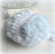 Light blue powder puff with frilled sheer finger grip. A lovely ice blue and ultra soft plush. Simple elegance with vintage charm. Even if you dont use body powder, these feminine puffs look so pretty as a decorative accent on your vanity... a truly feminine gift. Mothers and Grandmothers will greatly appreciate the nostalgia.  ~ Includes a complimentary Body Powder sample ~ Measures approx 4  inches across ( 10.2 cm ). Gift boxed.  Samples http://www.etsy.com/listing/6106...