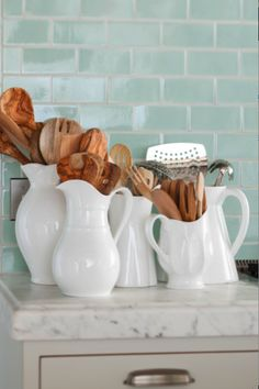 Repurpose a bounty of pitchers as handy countertop utensil storage. Repurpose a bounty of pitchers as handy countertop utensil storage. Kitchen Tiles, New Kitchen, Kitchen Decor, Kitchen Wood, Kitchen White, Vintage Kitchen, Life Kitchen, Kitchen Staging, Funny Kitchen