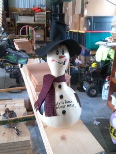 snowman gourd that reads family is forever love doesn't melt