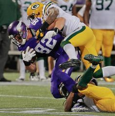 Minnesota Vikings tight end Kyle Rudolph (82) gets tackled by Green Bay Packers' M.D. Jennings (43) and Morgan Burnett
