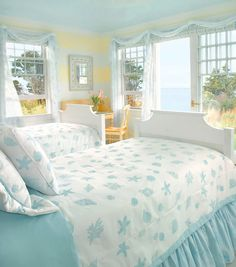 Coastal Bedroom with Breezy fabrics, an abundance of natural light, and a hint of sunshine yellow all nod to vacation days by the sea. Light blue seashells and coral decorate the beds lending an air of whimsy. (www.town-n-country - living.com )