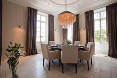 Dining in this period villa with it's mouldings, round table, and centre lamp. Classic and contemporary