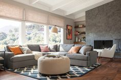 Gorgeous Light Gray Sectional Sofa Involving Round Tufted Coffee Table with Patterned Rug in Black and White