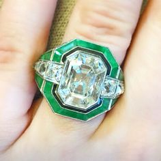 This stunning Art Deco style ring, set with a 5 carat diamond + black enamel + green hardstone, sold at the #ChristiesMagnificentJewels sale in NYC for $56,250! [Photo by @christiesjewels]  #engagement #engagementring #proposal #wedding #weddingdress #weddingplanning #SheSaidYes #ISaidYes #IDo #PutARingOnIt #ShowMeYourRings #ArtDeco #AntiqueEngagementRing #ArtDecoJewelry #AntiqueJewelry #EstateJewelry #VintageJewelry #Jewelry #Jewellery #MagnificentJewels #Diamond #Diamonds #EngagementRings