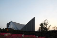 Built by PURE Architecture in Chongqing, China with date 2012. Images by Shu He Photography. The Chongqing Greenland Clubhouse is located halfway up the south side of the mountain in Hong'en Temple Forest Park,...