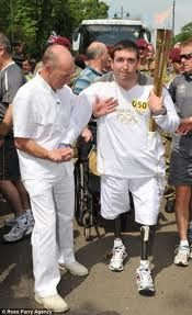 Ben Parkinson carries the Olympic torch.