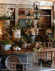 Garden display featuring lifelike herbs, lanterns, bird nests, burlap, and more
