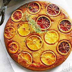 Instead of cloyingly sweet brown sugar pineapple, we've added tangy orange and fresh thyme for a totally grown-up take on the classic upside-down cake.