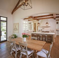Houston Residence by Thompson Custom Homes --- love the simple layout and spaciousness of this home without it being huge, love the high ceilings with beams, and the wall of windows