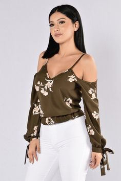 - Available in Olive and Navy - Cold shoulder Tie Top - Ruffle Hem - Flower Detail - Cropped Top - Made in USA - 100% Polyester