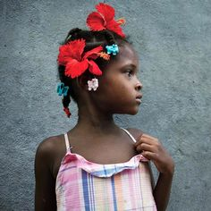 Six-year-old Tamara Pierre wears a hibiscus blossom in her hair in Ca Douche Haiti. Photograph by Myrmara Prophete 14. Bravo to the students of @fotokonbit for their incredible story in the December issue of @natgeo. Many thanks to the magazine for giving young Haitians an opportunity to express themselves and portray Haiti as they live and see it a proud and beautiful nation with proud people. -@maggiesteber  http://ngm.nationalgeographic.com/2015/12/haiti-photos-by-haitians-text…