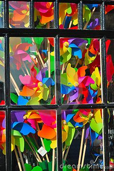 Repetition & colour = powerful visual statement.  Bright colorful window display by Paul Wishart, via Dreamstime
