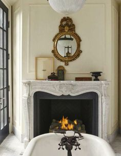 Darryl Carter's master bath features an antique French marble mantle and tub hardware from Kingston Brass