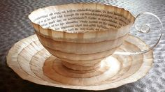 """Cecilia Levy is giving old books and comics a second chance by transforming them into beautiful 3D works of art. The Swedish artist cuts and pastes faded pages from books into gorgeous creations like teacups with saucers, eggs, bowls, and boots. """"My working material, paper – mainly from old books – is"""