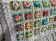 This colorful crochet granny rose throw is just stunningly beautiful. It is made from a total of 64 crocheted granny squares with a rose motif.