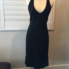 Moschino Cheap and Chic Black Halter Dress 6 Moschino Cheap and Chic Black Halter Dress.  Fully lined, ruffed bottom of dress.  Side zip.   Fits true to size. Great condition.  There is one really small, so small you don't notice it unless I point it out.  No one will ever see it, but obviously want to fully disclose. Size 6. Moschino Dresses Backless