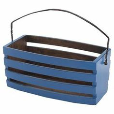 """Handcrafted pine wood basket with a forged iron handle.  Product: BasketConstruction Material: Pine wood and forged ironColor: BlueFeatures: HandcraftedDimensions: 8.5"""" H x 18"""" W x 9.5"""" D"""
