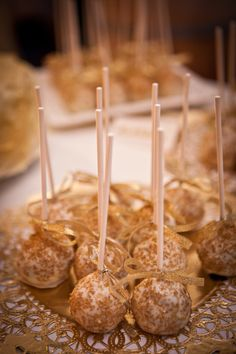 Huckleberry Cake Pops coating in edible gold glitter. Photo by Ifong Chen Photography