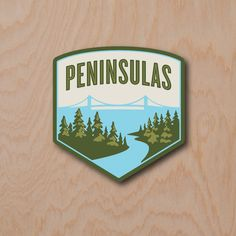 The Peninsulas signature logo sticker celebrates the land and lakes of the Great Lakes State (Michigan) with the iconic image of the mighty Mackinac Bridge