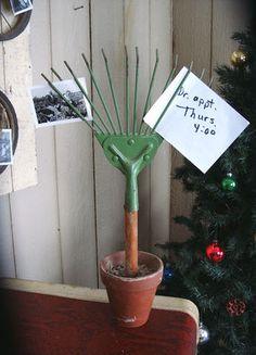 A mini metal rake gets re-purposed as a fun photo / note / recipe / etc holder!