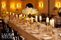 white/ivory and gold wedding centerpiece and decor. this could be our winner
