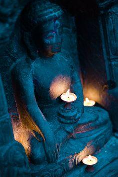 Buddha and candlelight at Swayambhunath, Kathmandu, Nepal