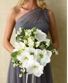 Winter wedding bouquet with amaryllis and snowberries. A similar design could be done in red with ilex berries.
