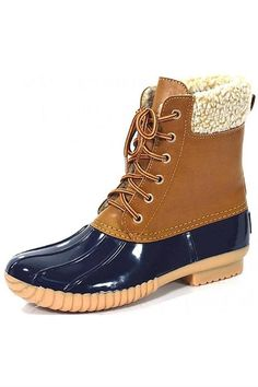 Navy rubber duck boot with fur inside.