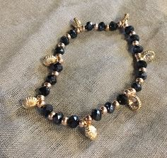 Beaded black faceted bracelet, gift for her, birthday present, gold charms, sparkle by Starboxjewellery on Etsy
