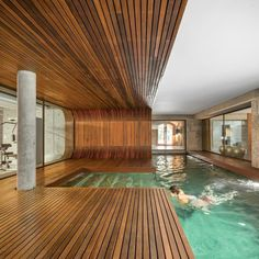 Be sure to follow @intdeshomes for all things residential inspiration from Interior Design's archives! Pictured here is an indoor pool—surrounded by iroko and lined in mosaic tiles—at a renovated Portuguese farmhouse by #ES1Arq. : FG+SG Architectural Photography/Photofoyer. #homes #IDhomes... - Interior Design Ideas, Interior Decor and Designs, Home Design Inspiration, Room Design Ideas, Interior Decorating, Furniture And Accessories