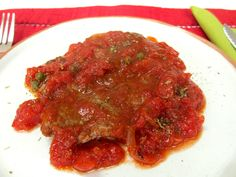 "A simple tasty recipe from my childhood: beef escalopes ""alla pizzaiola""."