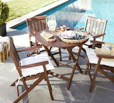 Folding bistro set from Pottery Barn. A little expensive for my taste, but I like the direction.
