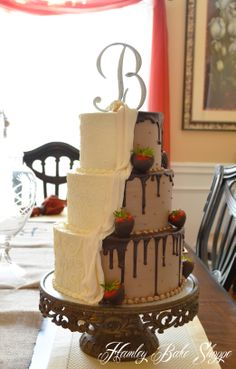 Combined Wedding & Groom's Cake - The bride and groom wanted to do a combine wedding and groom's cake. Brides Side: Vanilla BC with fondant swags Groom's Side: Chocolate BC w/ chocolate ganache and chocolate dipped strawberries