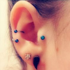 Conch Piercing with Body Spiral and coloured Balls. Nice! www.karmase7en.com the Only Buy One Choose One FREE Body Piercing Website.
