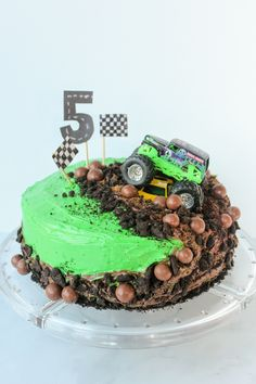 """Learn how to make a cool & EASY monster truck cake that your kids will LOVE! Topped with a yummy """"muddy"""" icing. Inspired by Monster Jam / Grave Digger Truck Digger Birthday Cake, Candy Birthday Cakes, Lego Birthday, Monster Truck Birthday Cake, Happy Birthday, Chocolate Malt, Chocolate Icing, Chocolate Cookies, Grave Digger Cake"""
