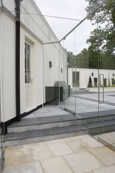 Frameless glass link with shaped glass units up stairs by IQ Glass Glass Porch, Glass Walkway, Glass Balcony, Glass Extension, House Extension Design, Exterior Doors With Glass, Wooden Staircases, Glass Room, Barn Kitchen
