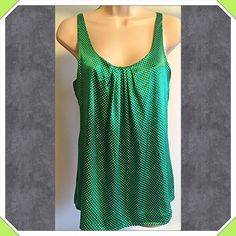 """❤️NWOT green & white polka dot cami top ❤️Gorgeous NWOT green & white polka dot cami top. So pretty & perfect for Spring! Measures approx 28"""" long & 34"""" bust. Size small. Built-in bra. Silky poly spandex blend. New, flawless condition. Also available in magenta (see separate listing). Bundle to save! NO TRADES Reasonable offers welcome via offer button. New York & Company Tops Camisoles"""