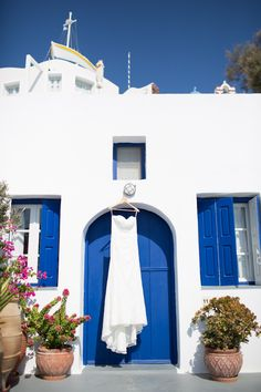 The blues and whites of Santorini. Dress by David's Bridal    Photography By / http://sarahfalugo.com