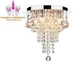 Height 30cm. Diameter 30cm. 4 X 40w G9 light bulb. Polished chrome with crystal decoration.