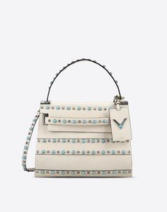 Are you looking for Valentino Garavani My Rockstud Rolling Single Handle Bag? Find out all the details at Valentino Online Boutique and shop designer icons to wear.