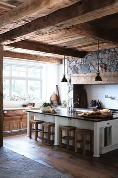 Wood kitchen with beams and bright window