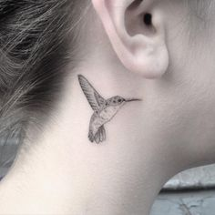 Small bird tattoo (2) - hummingbird neck tattoo on TattooChief.com