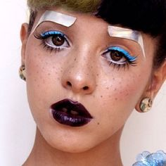 Melanie Martinez wore silver press-on eyebrows, neon blue winged eyeliner, and deep purple lipstick to make herself look like a Pidgin Doll for a photoshoot Makeup Inspo, Makeup Inspiration, Beauty Makeup, Makeup Ideas, Purple Lipstick, Blue Eyeshadow, Melanie Martinez Makeup, Holographic Makeup, Celebrity Makeup Looks